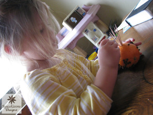 Concentrating hard on her craft!